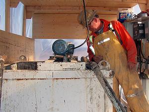 Peter White supervising soil mixing at jobsite